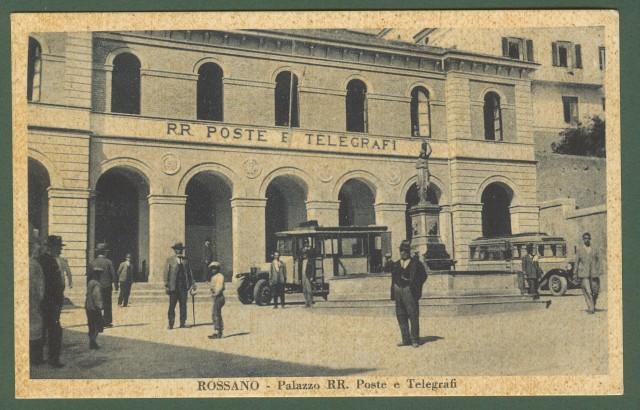 (Calabria - Cosenza) ROSSANO. Palazzo RR. Poste e Telegrafi. La piazza antistante l'edificio con persone e due corriere. Cartolina d'epoca viaggiata nel 1934.