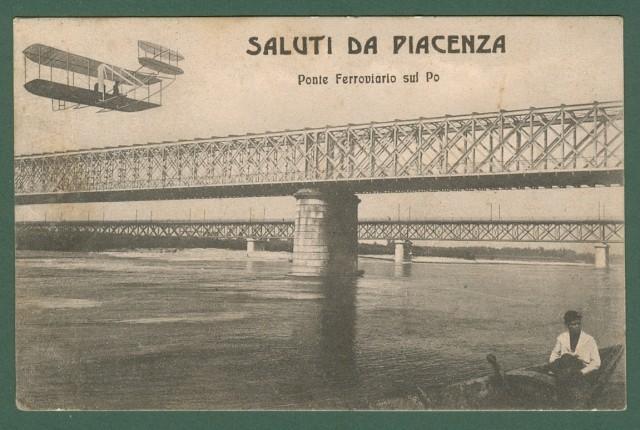 PIACENZA. Ponte ferroviario sul Po con aereo in volo.