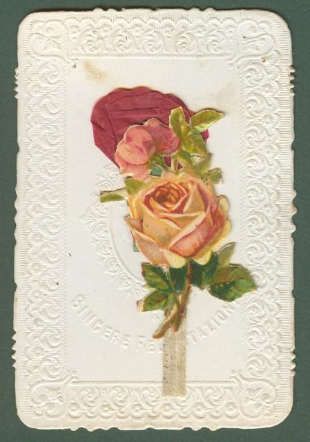 BIGLIETTO AUGURALE con applicata composizione di carta che si apre tirando la linguetta alla base. Inizio 1900