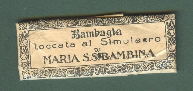 RELIQUIA. Bambagia toccata al Simulacro di MARIA S. S. BAMBINA.