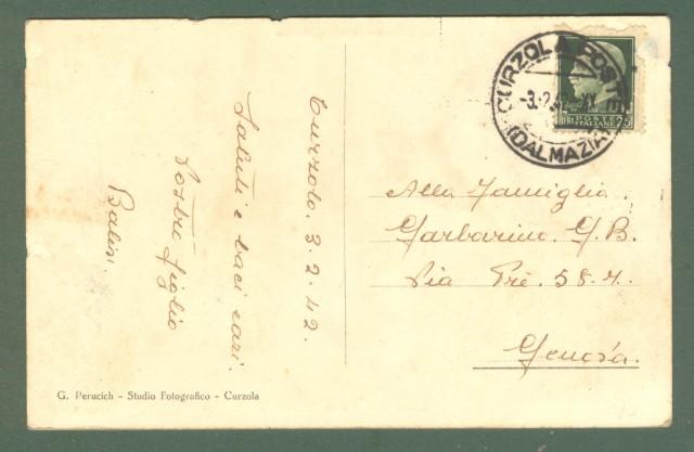 Storia postale Colonie. CURZOLA POSTE (DALMAZIA). Guller annullatore di cent. 25 Imperiale (difettoso) su cartolina per Genova del 03.02.1942
